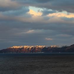 Oia in the distance atop Santorini.