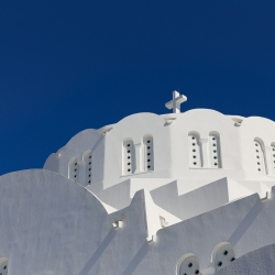 The white buildings are stunning against the blue sky.