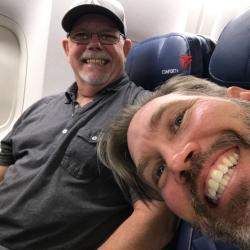 Greg and Chad happy to be on the plane to Egypt.